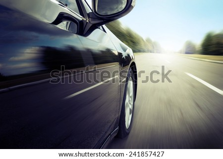 Blurred road and car, speed motion Royalty-Free Stock Photo #241857427