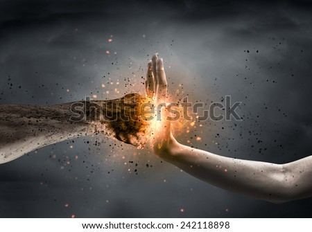 One hand preventing punch attack of another hand Royalty-Free Stock Photo #242118898