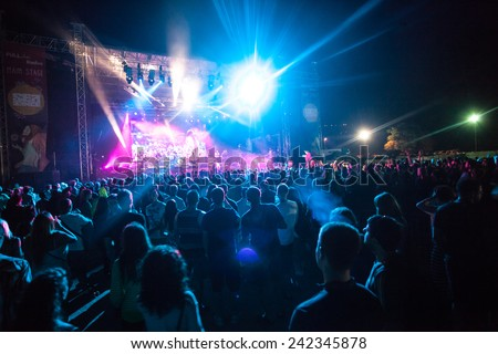 JAZ, MONTENEGRO - JULY 16: Audience infront of the Main Stage at SEA DANCE Music Festival - EXIT ADVENTURE, during EYESBURN performance, on July 16, 2014  at the Jaz beach near Budva, Montenegro. #242345878