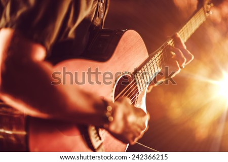 Acoustic Guitar Playing. Men Playing Acoustic Guitar Closeup Photography. Royalty-Free Stock Photo #242366215