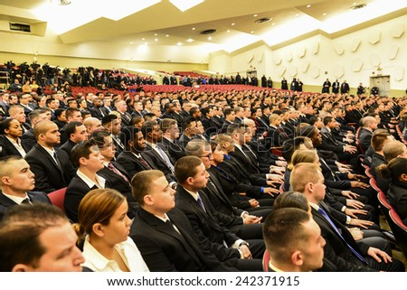 NEW YORK CITY - JANUARY 7 2015: Mayor Bill De Blasio presided over the swearing in of NYPD academy graduates with a moment of silence for victims of the terror attack against Charlie Hebdo in Paris #242371915