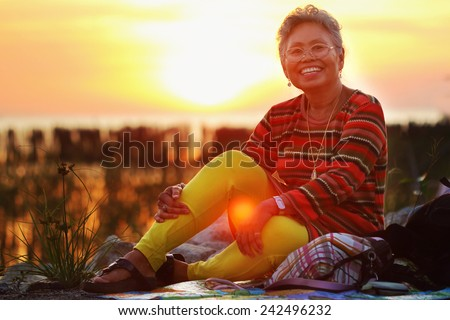Abstract picture, Asian senior wearing glasses in natural light. #242496232