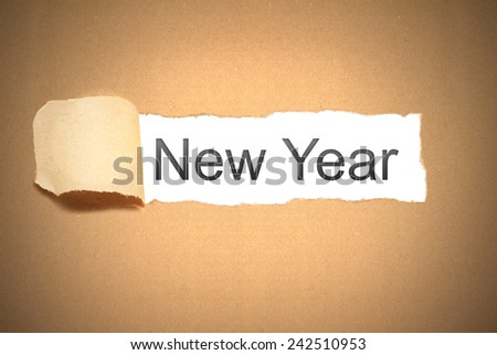 brown packaging paper torn to reveal new year #242510953