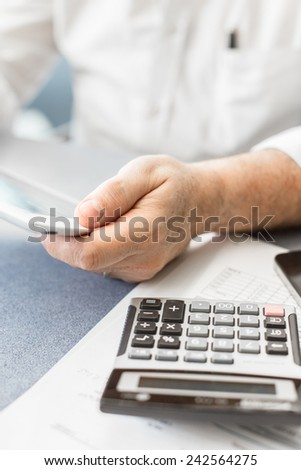 Businessman working with his tablet pc, in a modern office. #242564275