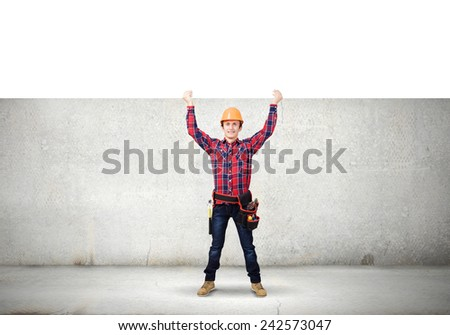 Young smiling craftsman holding white blank banner above head #242573047