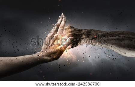One hand preventing punch attack of another hand Royalty-Free Stock Photo #242586700