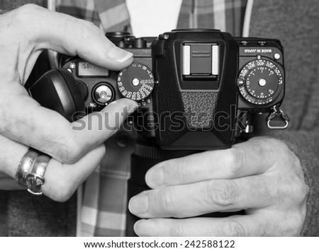 Adjusting controls on a digital camera or dslr - shutter speed.