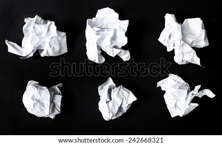 Crumpled paper on a black background #242668321