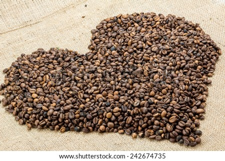 Coffee beans on brown jute background #242674735