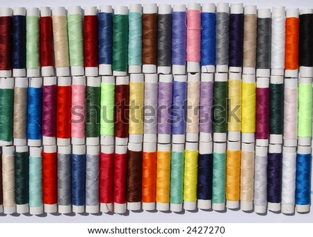 many different colored sewing cottons on reels #2427270