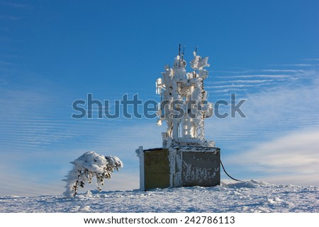 Antenna communications tower in snow #242786113