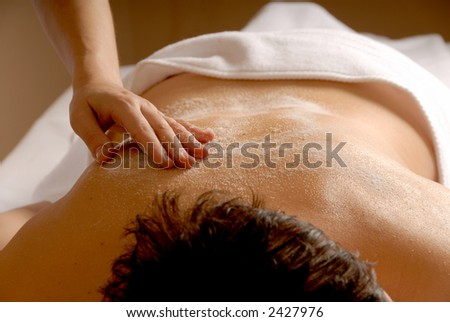 woman in a spa getting a salt glow #2427976