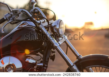 Motorcycle detail closeup front fork and headlight #242838760
