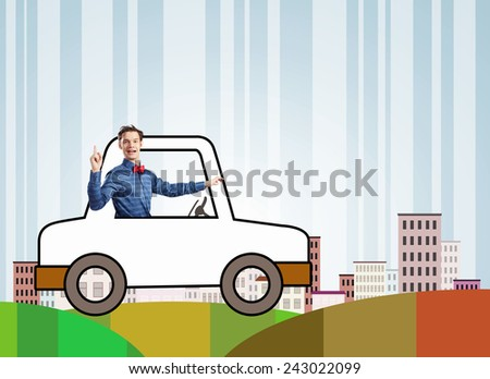 Young funny man driving little drawn car