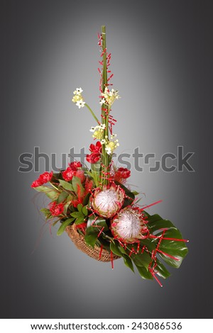 basket of flowers on a gray background #243086536