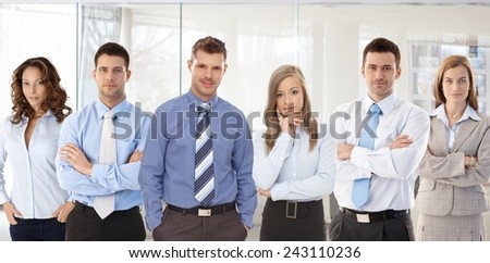 Team photo of successful young confident businesspeople standing at office. #243110236