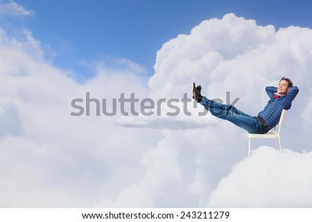 Young man sitting in chair with legs up and relaxing #243211279