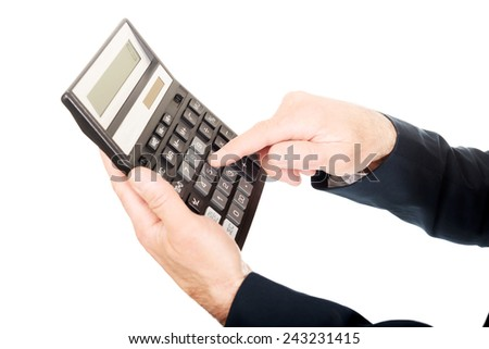 Financier's finger pushing the button on calculator. #243231415