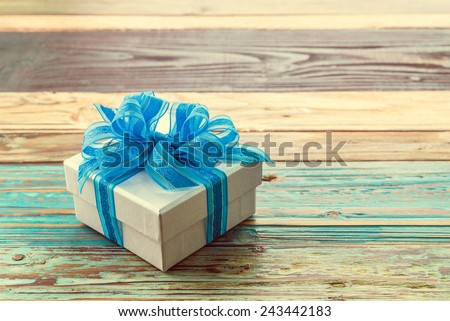 Gift box on wooden background - vintage effect style pictures