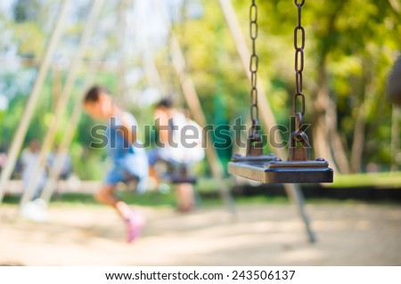 Set of chain swings on modern kids playground, kids swinging on back Royalty-Free Stock Photo #243506137