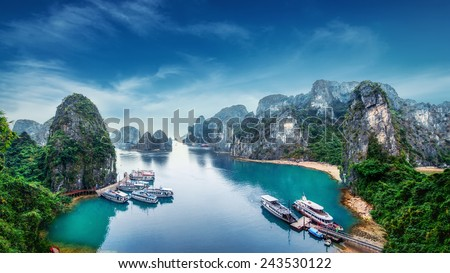 Tourist junks floating among limestone rocks at Ha Long Bay, South China Sea, Vietnam, Southeast Asia Royalty-Free Stock Photo #243530122