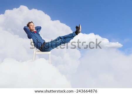 Young man sitting in chair with legs up and relaxing #243664876