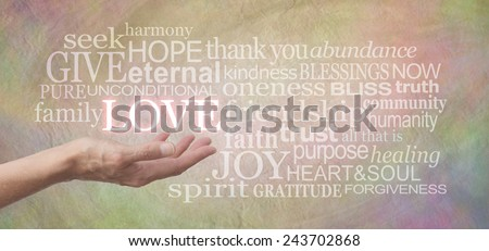 Sharing Love - Female hand outstretched with the word LOVE floating above, surrounded by love related words on a wide pastel colored rustic stone effect background