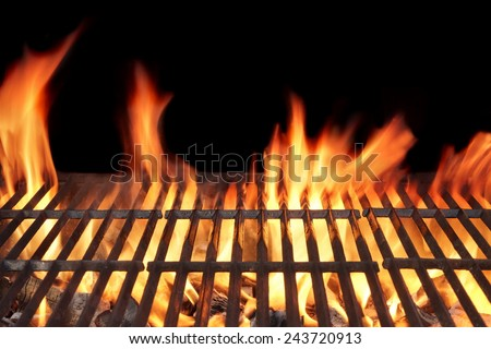 Barbecue Fire Grill close-up, isolated on Black Background Royalty-Free Stock Photo #243720913