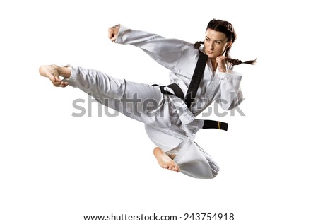 Professional female karate fighter isolated on the white background Royalty-Free Stock Photo #243754918