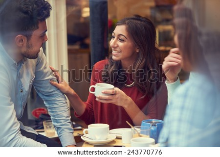 Group Of Friends In Caf�¢?? Relaxing Together Royalty-Free Stock Photo #243770776