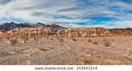Blue cloudy sky and mountains in Nevada #243841654