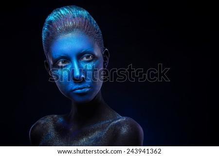 Beautiful woman with modern face art. Deep blue colour. Face Art Space #243941362