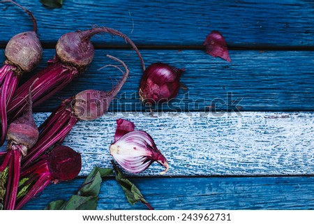 Fresh organic vegetables. Healthy herbs from garden  Red onion and red beet on a blue wooden. Rustic style. Healthy food concept, #243962731