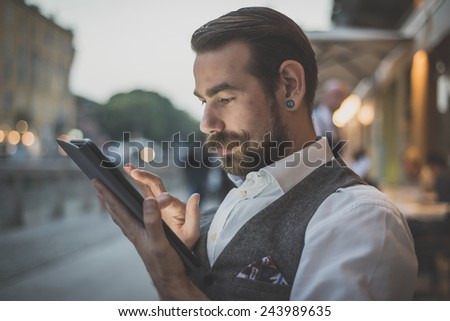 handsome big moustache hipster man using tablet sitting at the bar  #243989635