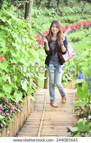 portrait asia young woman happy and smile on Doi tung garden, Dhiang rai, Thailand #244085665