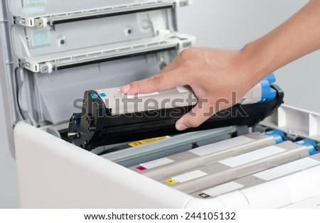 Male hand holding color printer toner #244105132