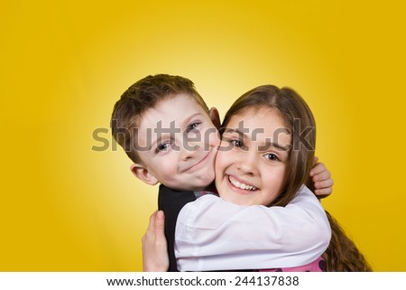 Happy brother and sister hugging over yellow background.Love ,Family,Friendship #244137838