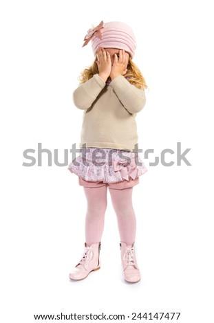 Blonde kid covering her eyes #244147477
