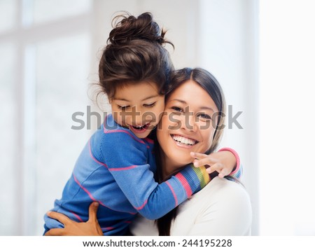 family, children and happy people concept - hugging mother and daughter #244195228