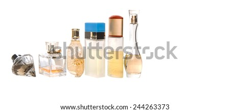 Variety of perfume bottles over background #244263373