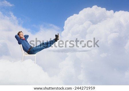 Young man sitting in chair with legs up and relaxing #244271959