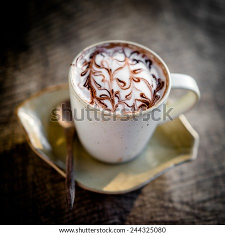 cup of coffee on wooden table #244325080