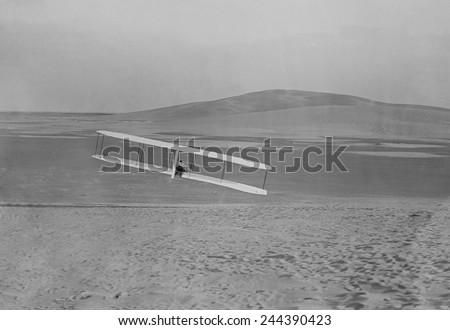 Wilbur Wright 1867-1912 making a right turn in a glider at Kitty Hawk North Carolina. October 24 1902. #244390423