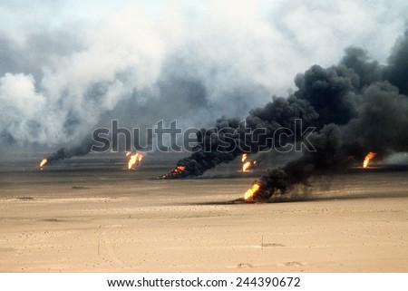 Oil well fires rage outside Kuwait City in the aftermath of the First Gulf War. Retreating Iraqi troops set fire to Kuwait's oil fields. Mar. 21 1991. Royalty-Free Stock Photo #244390672