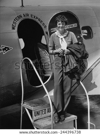 Amelia Earhart 1897-1937 standing in the door of a Western Airlines planes in California as she embarks to New York to make her first New York first public appearance at Carnegie Hall. 1930s. #244396738