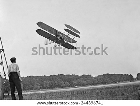 Wright's airplane in Army trial flights at Fort Meyer Virginia in July 1909. In 1908 the Wright Brothers contracted with the Army to develop an a two-seater paid 25 000 600 000 is 2010 equivalent. #244396741