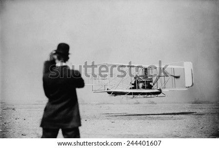 Wilbur Wright 1867-1912 takes off for a flight over New York harbor on Sept. 29 1909. Wilber made three flights including a 20 mile round trip from Governors Island to Grant's Tomb. #244401607