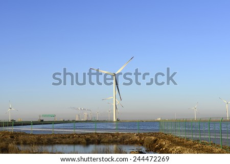 The beautiful windmill under the blue sky  #244472269