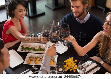 Friends celebrating life event in a restaurant #244506874