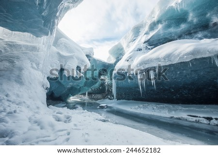 Glacial cave in vatnajokull in Iceland Royalty-Free Stock Photo #244652182